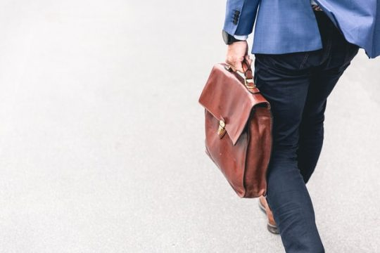 man carrying briefcase